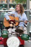 Street busker. Musician in the streets of Hanover, Germany: Drums, guitar and dreadlocks Stock Photos