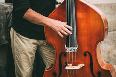 Street Busker Performing Jazz Music Outdoors. Close Up Of Musica. L Instrument Contrabass Royalty Free Stock Photo