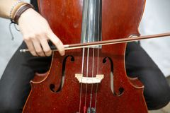 Street Busker Performing Jazz Music Outdoors. Close Up Of Musical Instrument. Contrabass Royalty Free Stock Photo