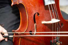 Street Busker Performing Jazz Music Outdoors. Close Up Of Musical Instrument. Contrabass Stock Photography
