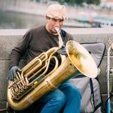 Street Busker performing jazz songs at the Charles Bridge in Pra. PRAGUE, CZECH REPUBLIC - OCTOBER 10, 2014: Old street Busker performing jazz songs at the Stock Images