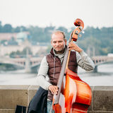 Street Busker performing jazz songs on the Charles Bridge in Pra Royalty Free Stock Images