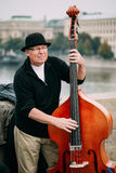 Street Busker performing jazz songs at the Charles Bridge in Pra. Prague, Czech Republic - October 10, 2014: Street Busker performing jazz songs at the Charles Royalty Free Stock Images