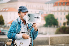 Street Busker performing jazz songs at the Charles. PRAGUE, CZECH REPUBLIC - OCTOBER 10, 2014: Street Busker performing jazz songs at the Charles Bridge in Royalty Free Stock Images