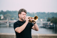 Street Busker performing jazz songs at the Charles. PRAGUE, CZECH REPUBLIC - OCTOBER 10, 2014: Street Busker performing jazz songs at the Charles Bridge in Stock Image