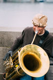 Street Busker performing jazz songs at the Charles. PRAGUE, CZECH REPUBLIC - OCTOBER 10, 2014: Street Busker performing jazz songs at the Charles Bridge in Royalty Free Stock Photo