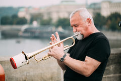 Street Busker performing jazz songs at the Charles. Prague, Czech Republic - October 10, 2014: Street Busker performing jazz songs at the Charles Bridge in Stock Images