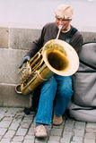 Street Busker performing jazz songs at the Charles. PRAGUE, CZECH REPUBLIC - OCTOBER 10, 2014: Street Busker performing jazz songs at the Charles Bridge in Royalty Free Stock Photography