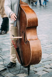 Street Busker performing jazz songs. Close up of. Contrabass Royalty Free Stock Image
