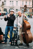 Street Busker performing jazz songs at the Old. PRAGUE, CZECH REPUBLIC - OCTOBER 10, 2014: Street Busker performing jazz songs at the Old Town Square in Prague Royalty Free Stock Photo