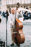 Street Busker performing jazz songs at the Old. PRAGUE, CZECH REPUBLIC - OCTOBER 10, 2014: Street Busker performing jazz songs at the Old Town Square in Prague Royalty Free Stock Images