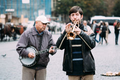 Street Busker performing jazz songs at the Old. PRAGUE, CZECH REPUBLIC - OCTOBER 10, 2014: Street Busker performing jazz songs at the Old Town Square in Prague Stock Photography