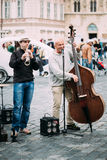 Street Busker performing jazz songs at the Old Town Square in Prague Royalty Free Stock Image