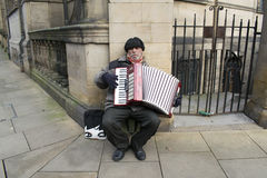Street Busker Playing An Accordion In Sheffield City Centre. Royalty Free Stock Photo
