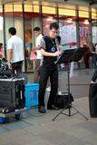 Street busker in Singapore Stock Images