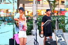 Street busker in Singapore Stock Image