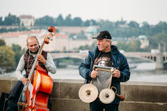 Street Buskers performing jazz songs on the Charles Bridge in Pr. PRAGUE, CZECH REPUBLIC - OCTOBER 8, 2014: Street Buskers performing jazz songs on the Charles Royalty Free Stock Images