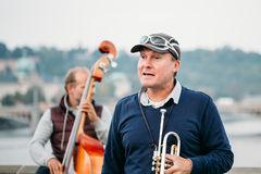 Street Buskers performing jazz songs on the Charles Bridge in Prague. PRAGUE, CZECH REPUBLIC - OCTOBER 8, 2014: Street Buskers performing jazz songs on the Stock Images