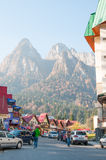 Street in busteni city. With lots of touristic shops and with the mountains in the background Royalty Free Stock Image
