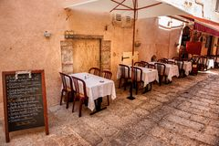 Street cafè. A small street café in Bonifacio city at the southern most tip of Corsica (France Royalty Free Stock Photography