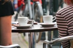 Street café table. Two cups on a street café table closeup Stock Photo