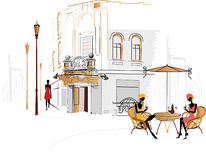 Street cafe. Outdoor café with stylized girls in the old part of town Stock Image