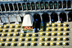 Street cafe. The view from above of a colorful yellow tables of a street restaurant located on St. mark's square in Venice Stock Images