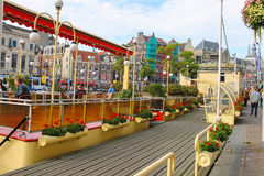 Street cafe at berth near the water in Amsterdam, Netherlands Royalty Free Stock Photos