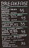 Street cafe breakfast menu written in chalk on a blackboard Stock Photography