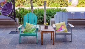 Street Cafe Chairs For Relaxing. Street cafe chairs and cushions for relaxing while shopping Royalty Free Stock Photo