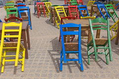 Street cafe chairs tables colors Stock Photography