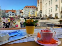Street Cafe in the city Empty tables and chair waiting People Relax and cup of coffee travel to Europe Baltic state Old Town Of Ta. Llinn city lifestyle Urban royalty free stock photo