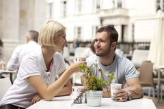 Street cafe. Couple having coffee and flirting in street cafe stock photos