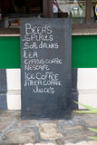 Street cafe drinks list on black chalkboard Stock Images