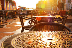 Street cafe early morning. Rising sun Royalty Free Stock Images