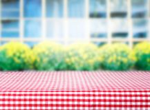 Product display table covered checkered red picnic cloth. Street cafe empty space table. Red checkered tablecloth texture top view background.Product display or Stock Images