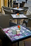 Street cafe. Empty tables on the street with tulips on them outside a cafe bar or restaurant Royalty Free Stock Photography