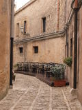 Street Cafe in Erice. Little street in Erice near Trapani royalty free stock photos