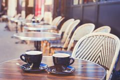Street cafe in Europe, two cups of coffee. On cozy vintage terrace royalty free stock photos