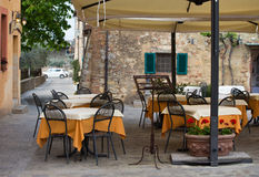 Street cafe at the Italy. Tables and chairs of street cafe at the Italy royalty free stock photo