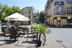 Street cafe in Kazimierz quarter, Krakow, Poland. Historical buildings in the background Royalty Free Stock Photo