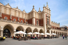 The street cafe in Krakow Cloth Hall at the main market square Stock Photos
