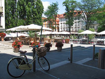 A street cafe in Ljubljana. Parked bike. Bicycles parked in the street royalty free stock images
