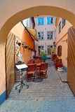 Street cafe in medieval town Stock Photography