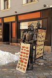 Street cafe menu board and knight in Old Town, Bratislava stock photos