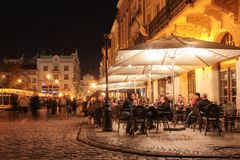 Street cafe on the old streets of the night city. stock photography