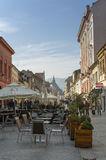 Street cafe in the the Old Town of Brasov royalty free stock photo