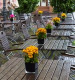 Street cafe in the rain. Tables and chairs in the rain drops Stock Images