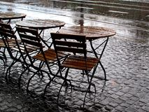 Street cafe in rainy weather Stock Images