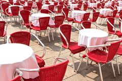Street cafe with red chairs Stock Images